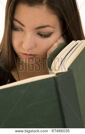 Teen Girl Contemplating While Reading A School  Book