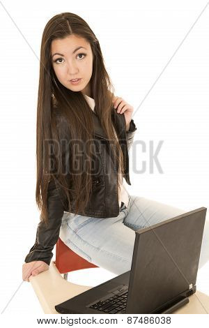School Girl Wearing A Leather Jacket Sitting With Computer On Desk