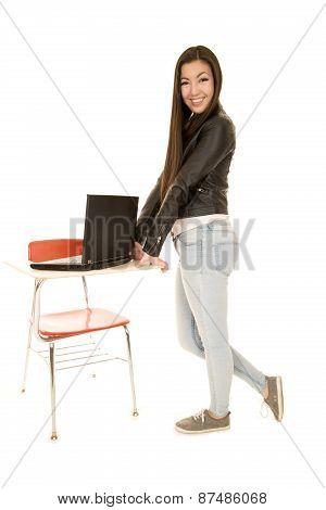 Cute Young Woman Standing By Desk With Computer