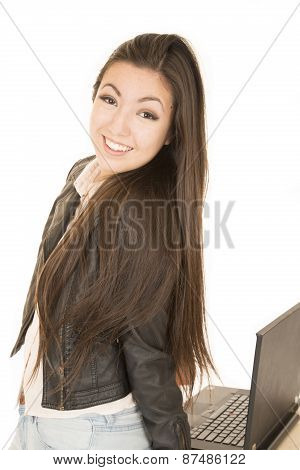 Asian American Teen Girl Posing By Her Computer