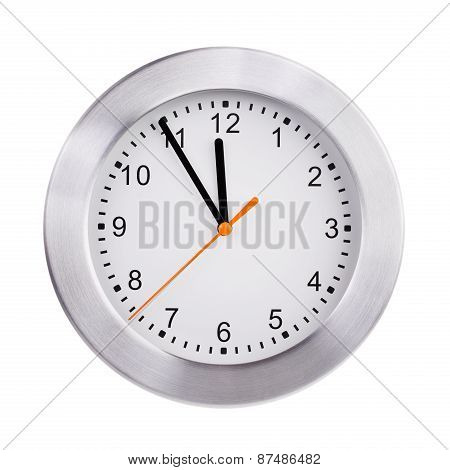 Round Clock Shows Five Minutes To Twelve