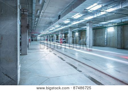 Car Lights In The Big Underground City Parking.