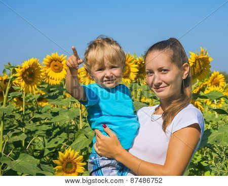 Mum With Small Son Among Sunflowers