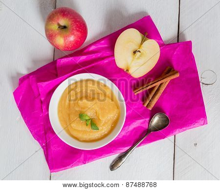 Applesauce On Pink Paper And Spoon