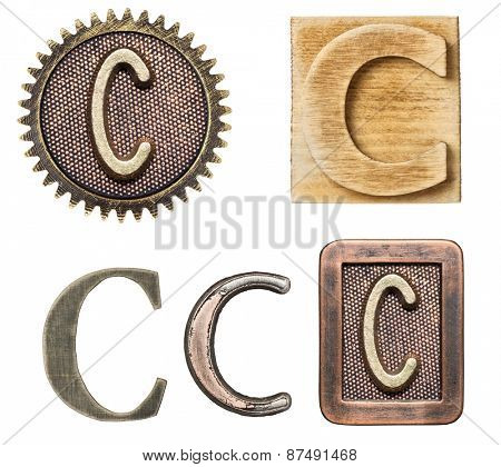 Alphabet made of wood and metal. Letter C