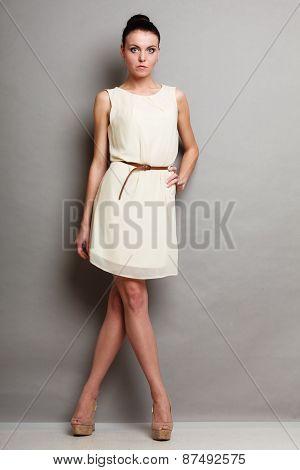 Glamour Girl In White Dress On Gray