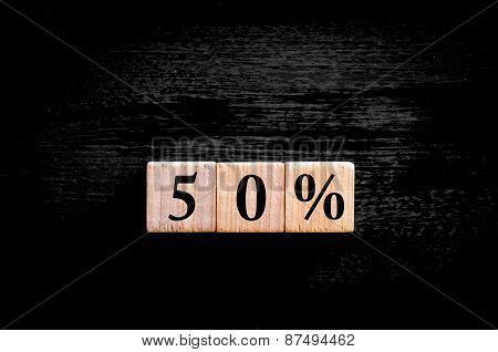 Fifty Percent Symbol Isolated On Black Background With Copy Space