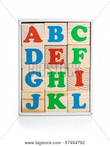 alphabet wood bricks in box isolated on white