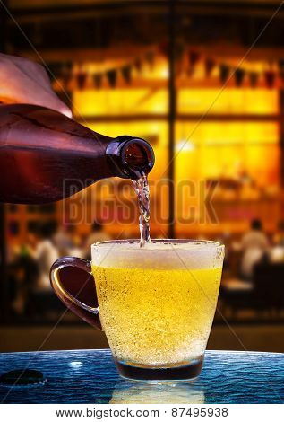 Lager Beer Drain From Bottle To Glass On Table With Beautiful Lighting Of Snack Bar Use For Alcohol