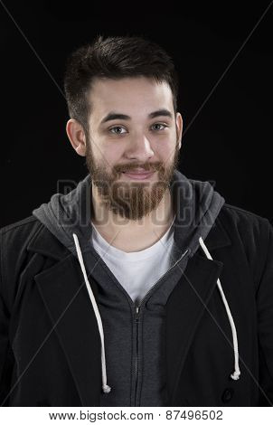 Goatee Young Man in Jacket Looking at Camera