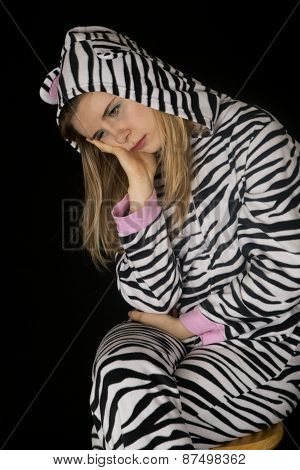 Depressed Expression On A Woman's Face Wearing Cat Pajamas
