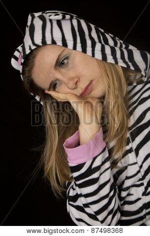 Sad Young Woman Wearing Black And White Striped Cat Pajamas