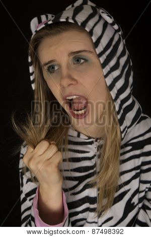 Woman Wearing Striped Cat Pajamas Showing A Fist Closed Roar