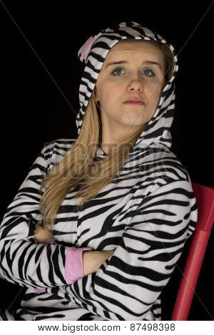 Confident Young Woman Wearing Cat Pajamas With Her Arms Folded