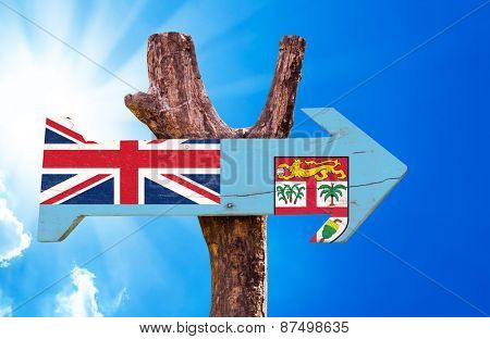 Fiji Flag wooden sign with sky background
