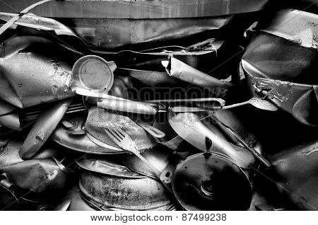 Junk Pile Up Of Old Compressed Utensils And Pots In Iblack And White