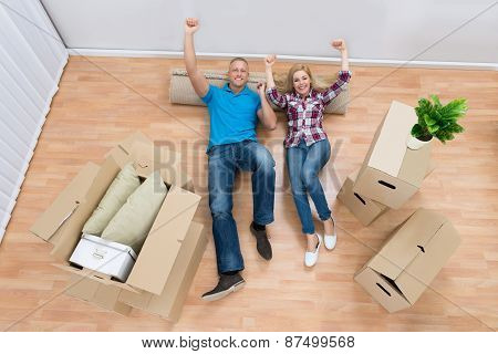 Excited Couple Relaxing At New Home