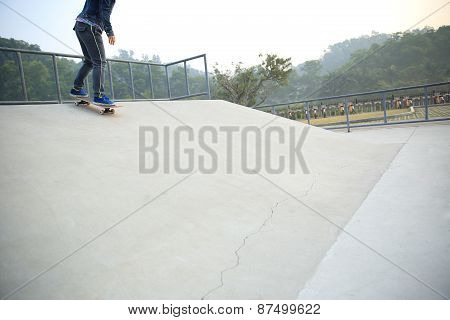 skateboarder riding on skateboard at skate park