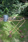 pic of pegging  - Old clothes washing basket trolley in backyard with a metal peg tin - JPG