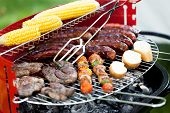 picture of frazzled  - Closeup of grill full of delicious food - JPG