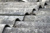 image of roof tile  - The roof of an old house covered with gray tiles - JPG