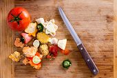 picture of knife  - Organic Wastes from Veggies and Spices Can be Used to Compost Garden Soil on Top of Wooden Chopping Board with Kitchen Knife - JPG
