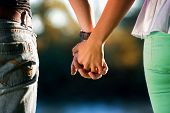 pic of heterosexual couple  - Heterosexual couple holding Hands - JPG
