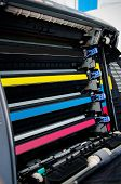 image of dtp  - Close up of color laser printer toners cartridges - JPG