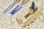 picture of chisel  - Two chisels and one spokeshave lying in wooden shavings - JPG