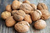 stock photo of walnut-tree  - Lots of big healthy walnuts in shells - JPG