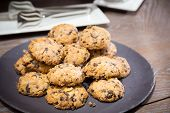 pic of baked raisin cookies  - Cookies with raisins on wooden table - JPG