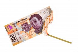 picture of pesos  - Peso bill being burned by a lid match - JPG
