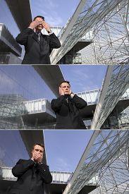 stock photo of evil  - business man see no evil hear no evil speak no evil three monkeys concept - JPG