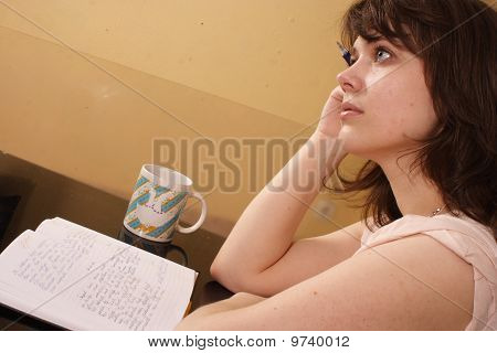 young beautiful woman writing in her diary