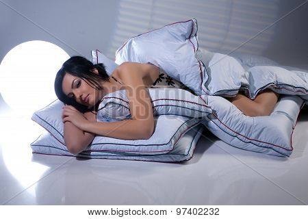 Woman And Pillows