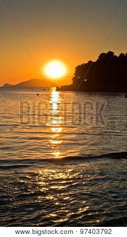 Sunset at sea with Turtle island in background,Sithonia