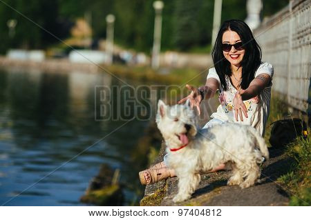 girl with a dog on the shore