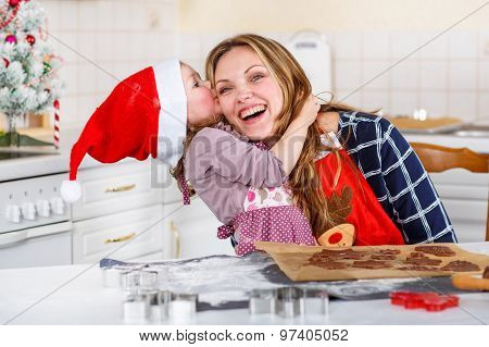 Mother And Little Kid Girl Baking Gingerbread Cookies For Christmas