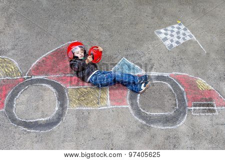 Little Boy Having Fun With Race Car Drawing With Chalks