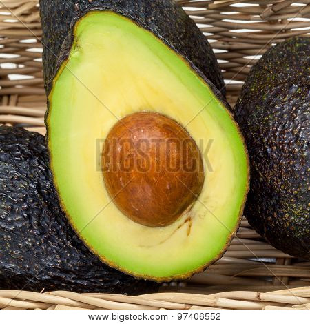Halved Avocado With Core - In Macro Shot.