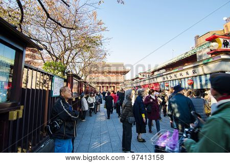 Tokyo, Japan - November 21, 2013: Tourists Shopping At Nakamise Shopping Street In Asakusa