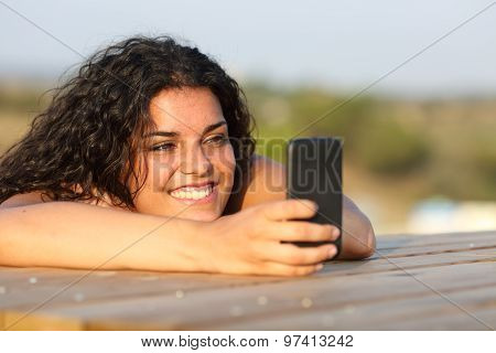 Funny Girl Watching Media In Smart Phone