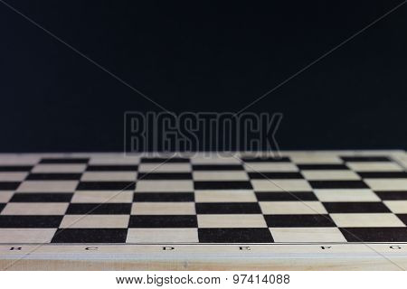 Woode Empty Chess Board. Checkerboard Black Background.