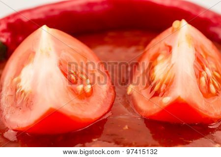 Cut Ripe Tomatoes On The Background Of Ketchup. Homemade, Healthy Vegetarian Food