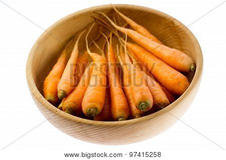 Fresh Carrots In Wooden Plate On White Background. Vegetarian Food