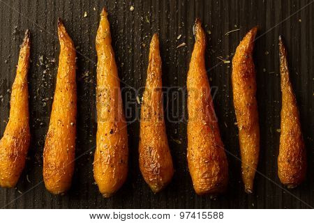 Whole Roasted Carrots With Spices In A Skillet. Vegetarian Healthy Food