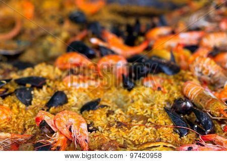 Traditional Paella With Seafood In A Market