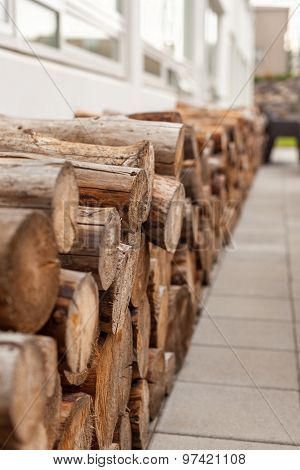 Logs Woodpile Near Modern Building House Wall