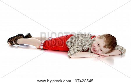 Fun boy lying on the floor