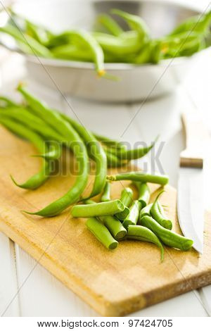 chopped green beans on kitchen table